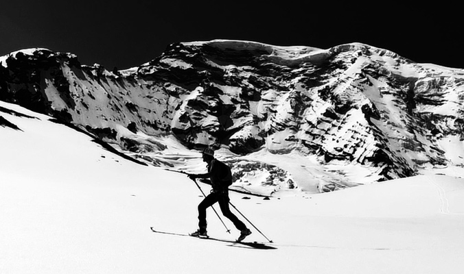 Nick Elson skinning along the north side of Mt. Rainier. [Photo] Eric Carter