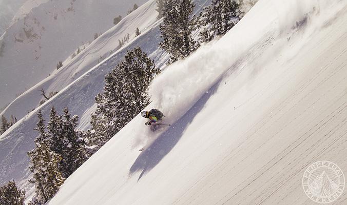 Ian Provo skis down Emma Ridge at sunset