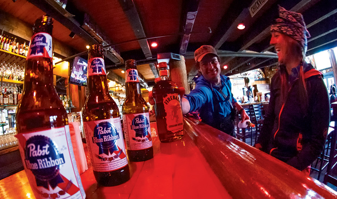 Tour planning and hydration at the Mangy Moose. [Photo] John Slaughter