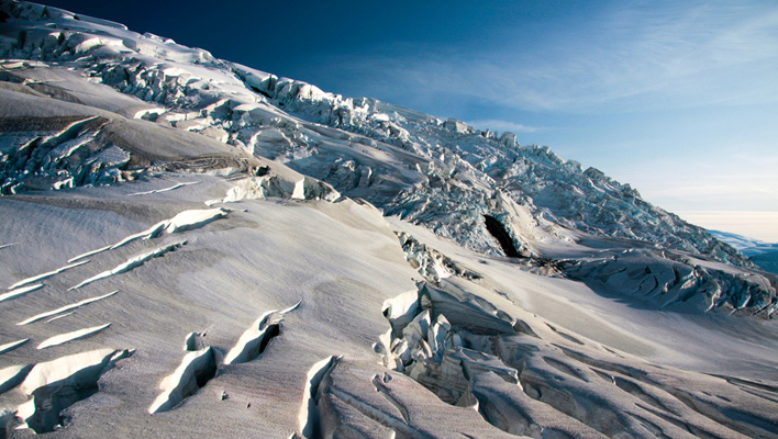 A retreating, climate-change-affected glacier in Icy Bay, Alaska. [Photo] U.S. Geological Survey