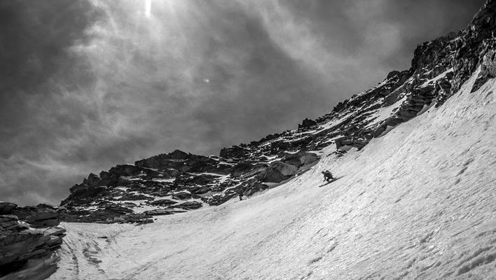 Riley Soderquist linking turns through fresh corn snow [Photo] Jordan White