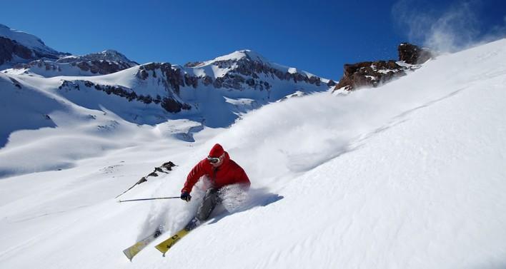 Skier cruising bluebird pow in Valle Nevado, Chile [Photo] Courtesy Sass Global Travel