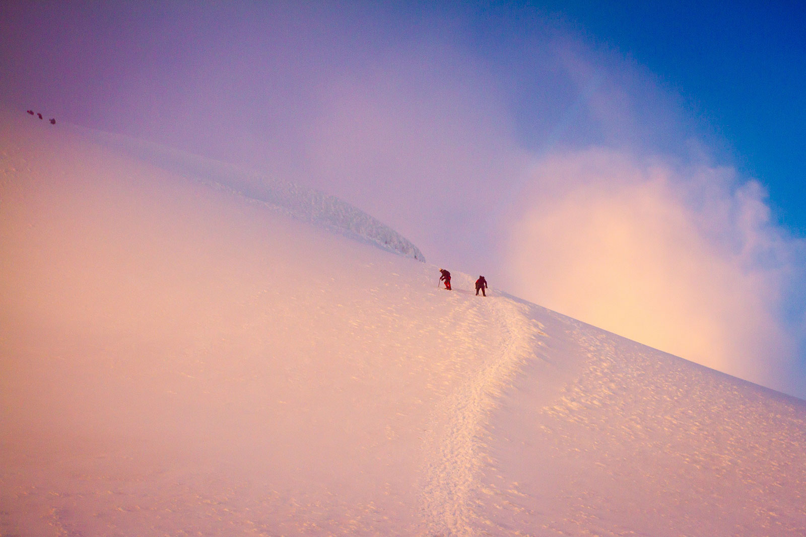 The perks of an alpine start: Joaquin Andino and Adam Moszynski soak up Cotopaxi's first light. [Photo] TJ David
