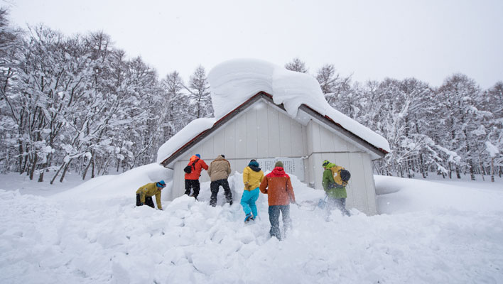 Digging out the Shokatan Hut, where the Hokkaido Backcountry Club—the business behind the Shiribetsu-dake heli operation—hopes to run cat-assisted ski trips on Hokkaido's Shokatan Peninsula. [Photo] Freya Fennwood