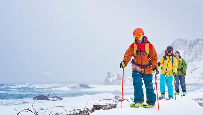 Adam U leads the seaside walk alongside the Sea of Japan. [Photo] Freya Fennwood