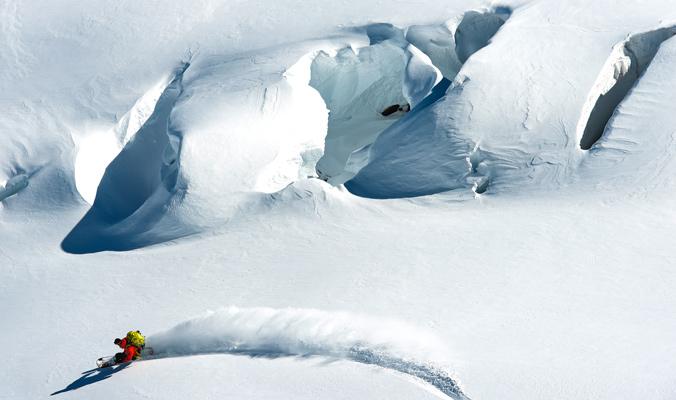 Ben Starkey carves a beautiful turn on Mt. Rainier. | [Photo] Jason Hummel