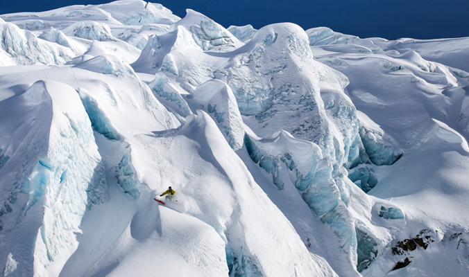 """""""I've always been drawn to the colors and shapes that glacial ice provides. KC Deane finds a nice little pow stash tucked away on this calving glacier."""" 