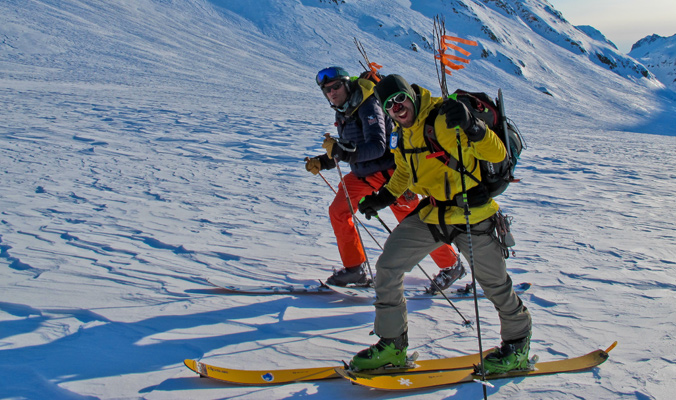 Jeff Dostie (in yellow) and Brennan Lagasse out for a skin on a long, cold day at Tour Camp. [PHoto] Jules Hanna