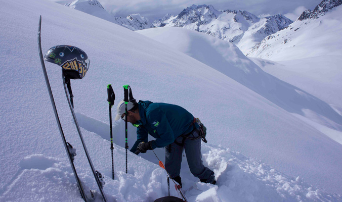 Jeff Dostie digging a pit to check on snow conditions throughout the day. [Photo] Brennan Lagasse