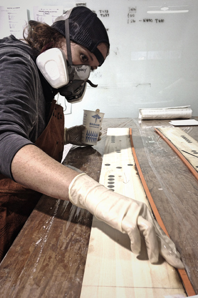 Stephanie Nitsch hard at work building boards. [Photo] Margie Richlen