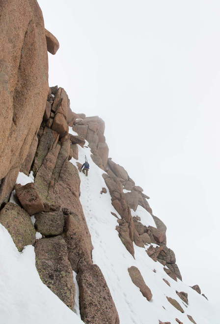 Austin Porzak carefully working his way to the summit of Sunlight. [Photo] Bjorn Bauer