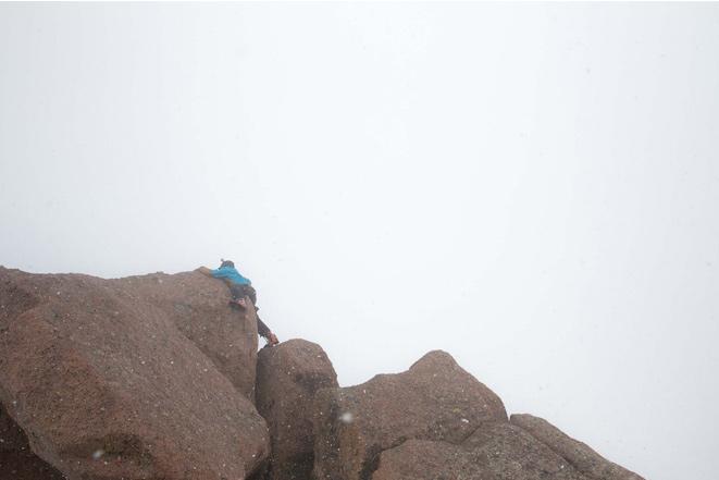 "Logan Jauernigg demonstrating ""The leap of faith"" move to the summit block. [Photo] Bjorn Bauer"