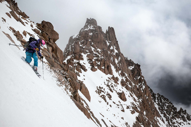 Lucy Sackbauer dropping the knee in front of the Sunlight Pinnacle. [Photo] Bjorn Bauer