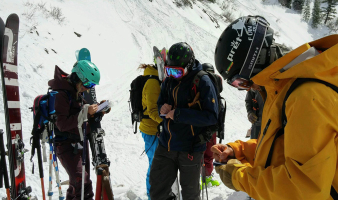 Mitchell on far left takes notes about the skis she has been testing. [Photo] Louise Lintilhac