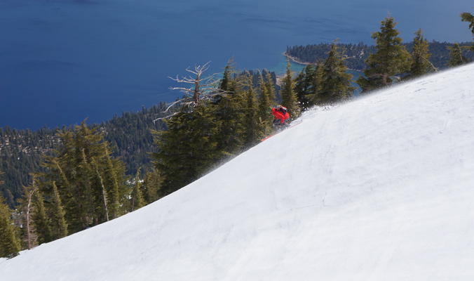 Noah Howell carves a line in the sun with Emerald Bay in the background. | Lake Tahoe, Calif. | Photo: Donny Roth