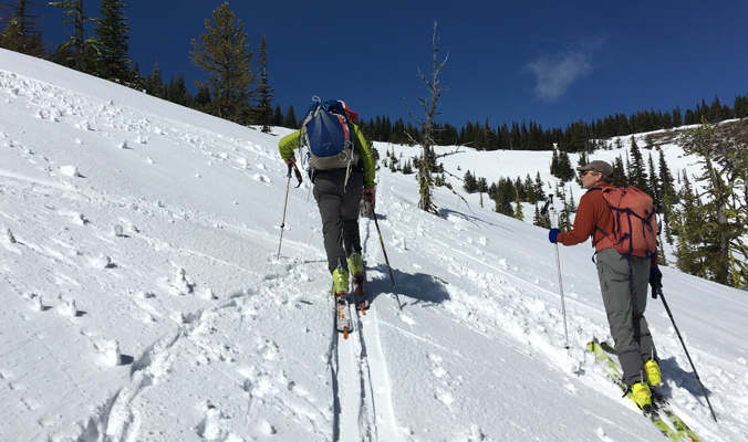 Mike Rolfs and Andy Dappen, El Sendero board members, chat as they skin up Stemilt Basin.   Wenatchee, Washington   Photo: Lucy Higgins