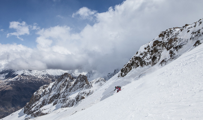 Te mountains of La Grave form a picturesque backdrop for Holly Walker doing some spring skiing.