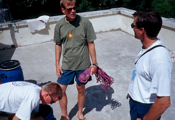 David Bridges (left), Conrad Anker (middle) and Alex Lowe sorting gear on a rooftop in Kathmandu before the 1999 Shishapangma trip. [Photo] Andrew McLean
