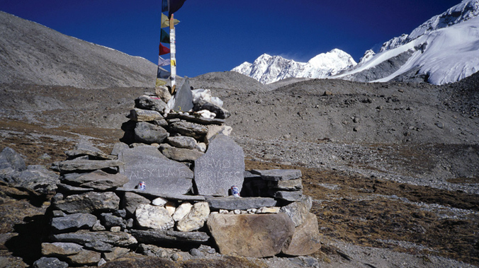 A stone memorial bench to Lowe and Bridges at the Shishapangma base camp. [Photo] Andrew McLean