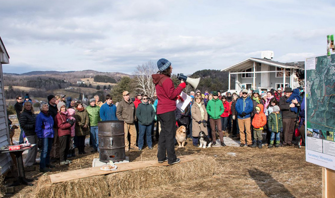 More than 150 community members gathered around the base of the new towrope to celebrate the acquisition and conservation of 468 acres, now owned by the Town of West Windsor. [Photo] Ascutney Outdoors