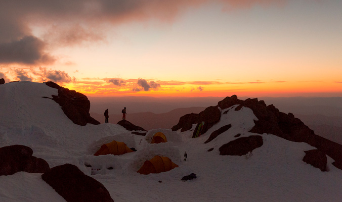 Nat and Anna Segal watch the sunset at their Mt Townsend campsite in the Kosciuszko National Park. [Photo] Teddy Laycock