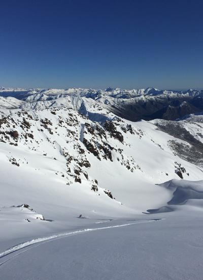 Taran makes turns under the blue skies of Valle Hermoso. [Photo] Courtesy Alex Taran