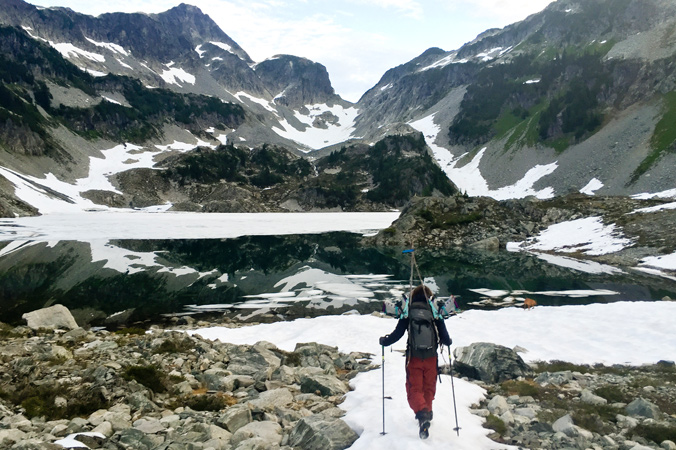 Kate Zessel navigates the melting snow of Tricouni. [Photo] Abby Cooper