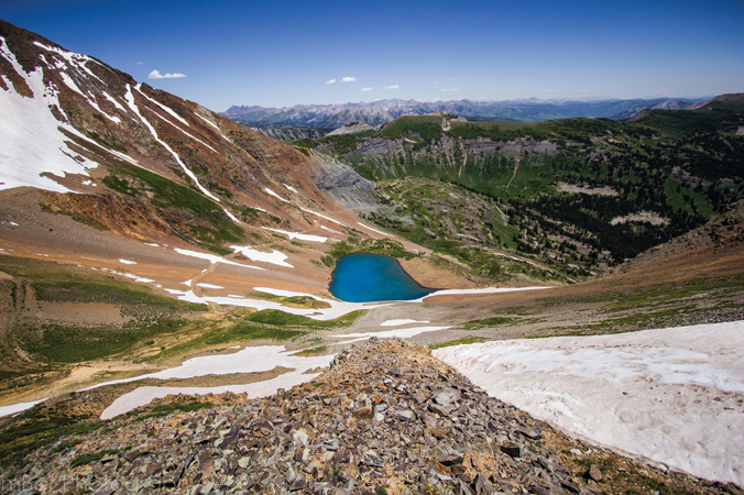The slopes of Mt. Owen give way to Green Lake below. [Photo]