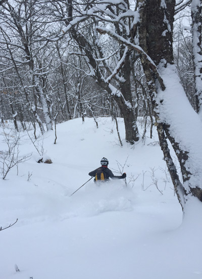 Mike Moriarty breathes in the cold smoke in Vermont Hardwoods. [Photo] Courtesy NEKBC