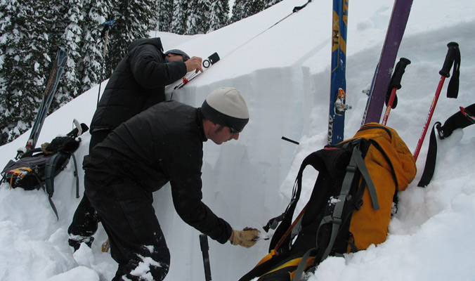 Don Sharaf and John Fitzgerald work together on digging an efficient pit. [Photo] Courtesy American Avalanche Institute