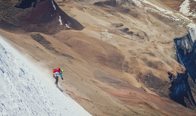 Kim Havell skis the line between snow and dirt.