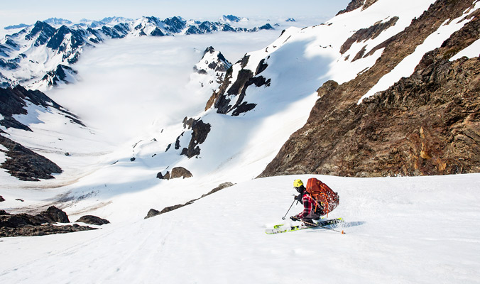 Day 6: Tim Black descends from our camp on Flypaper Pass toward Anderson Glacier. The days ahead can be seen in the distance.