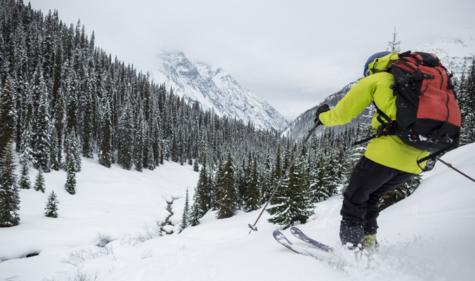 A skier enjoys the goods at Rogers Pass. [Photo] R. Bray for Parks Canada