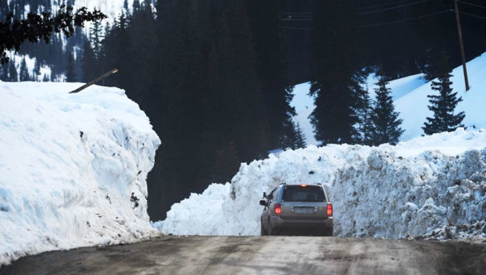 Above-average snowpack across the West delays pass openings